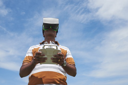 Man in VR glasses launching drone