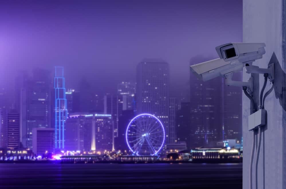 Surveillance Security Camera or CCTV over Hong Kong night city