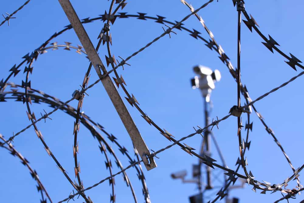 Barbed wire fence and surveillance cameras provide security