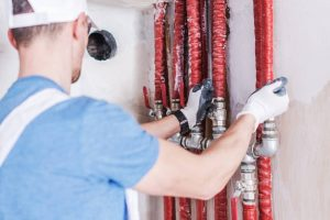 Plumbing Water Supply Check. Caucasian Plumber Worker Testing