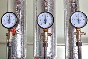 Three pressure gauge in boiler room, next to heat conductor