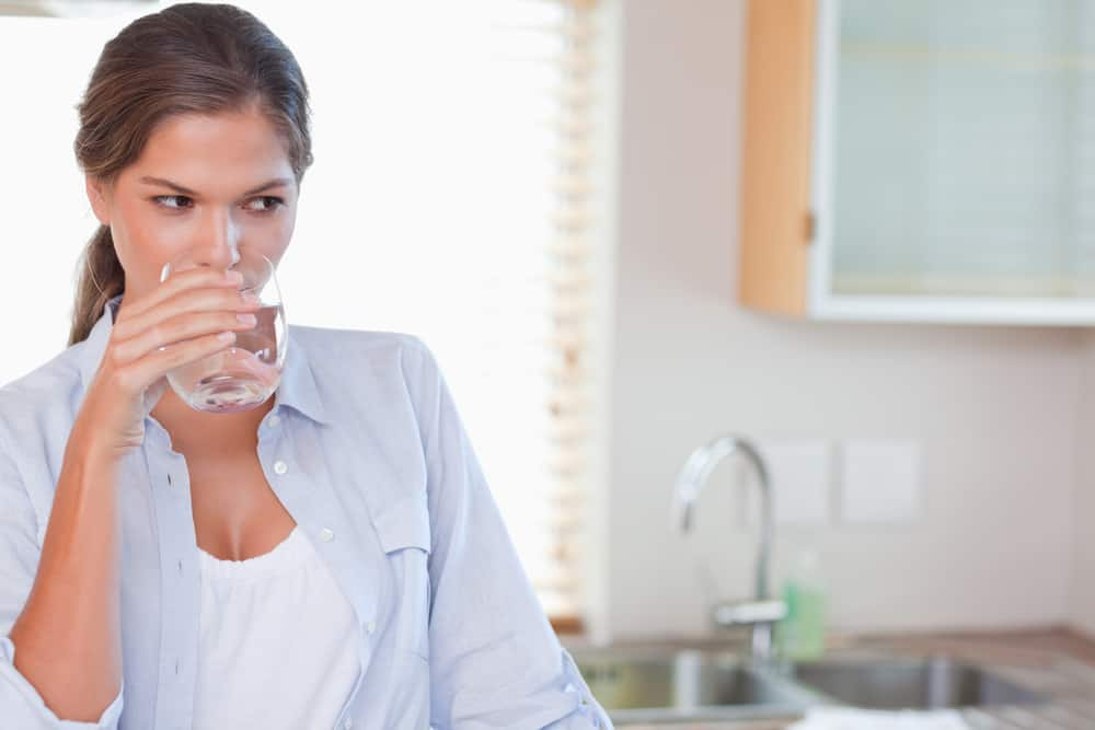 Gorgeous woman drinking a glass of water