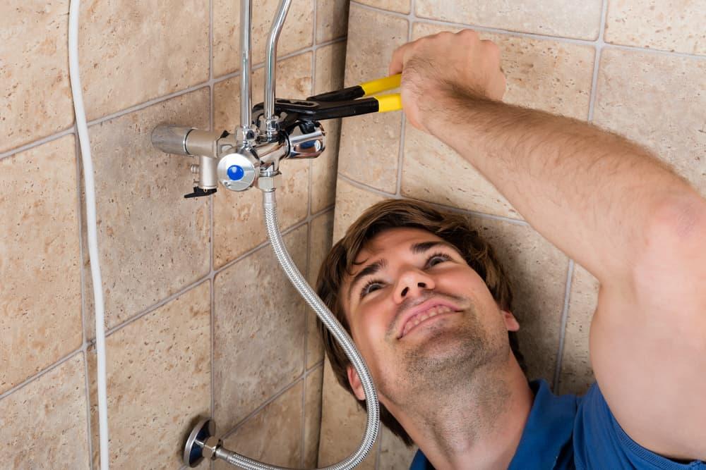 Plumber Repairing Electric Water Heater