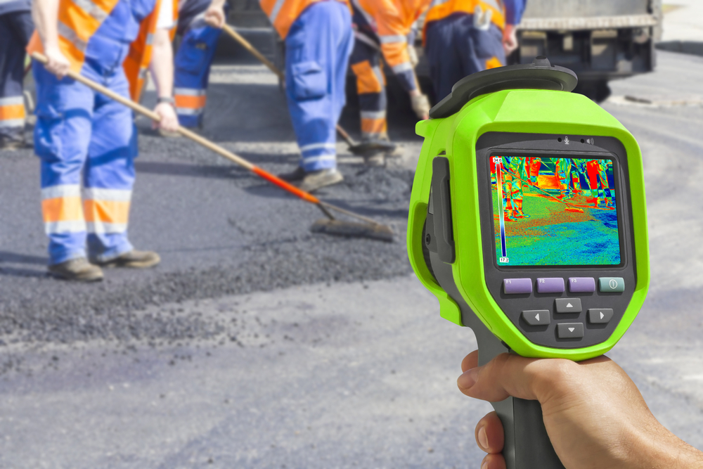 Recording Workers With Infrared Thermal Thermometer