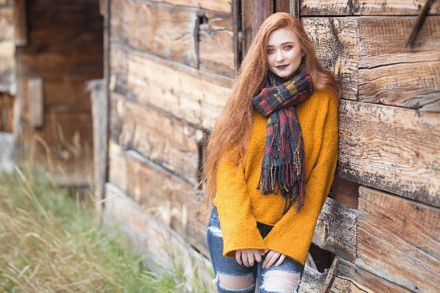 a female model wearing a scarf